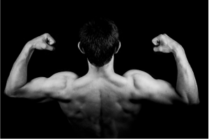 black and white image of a strong man flexing
